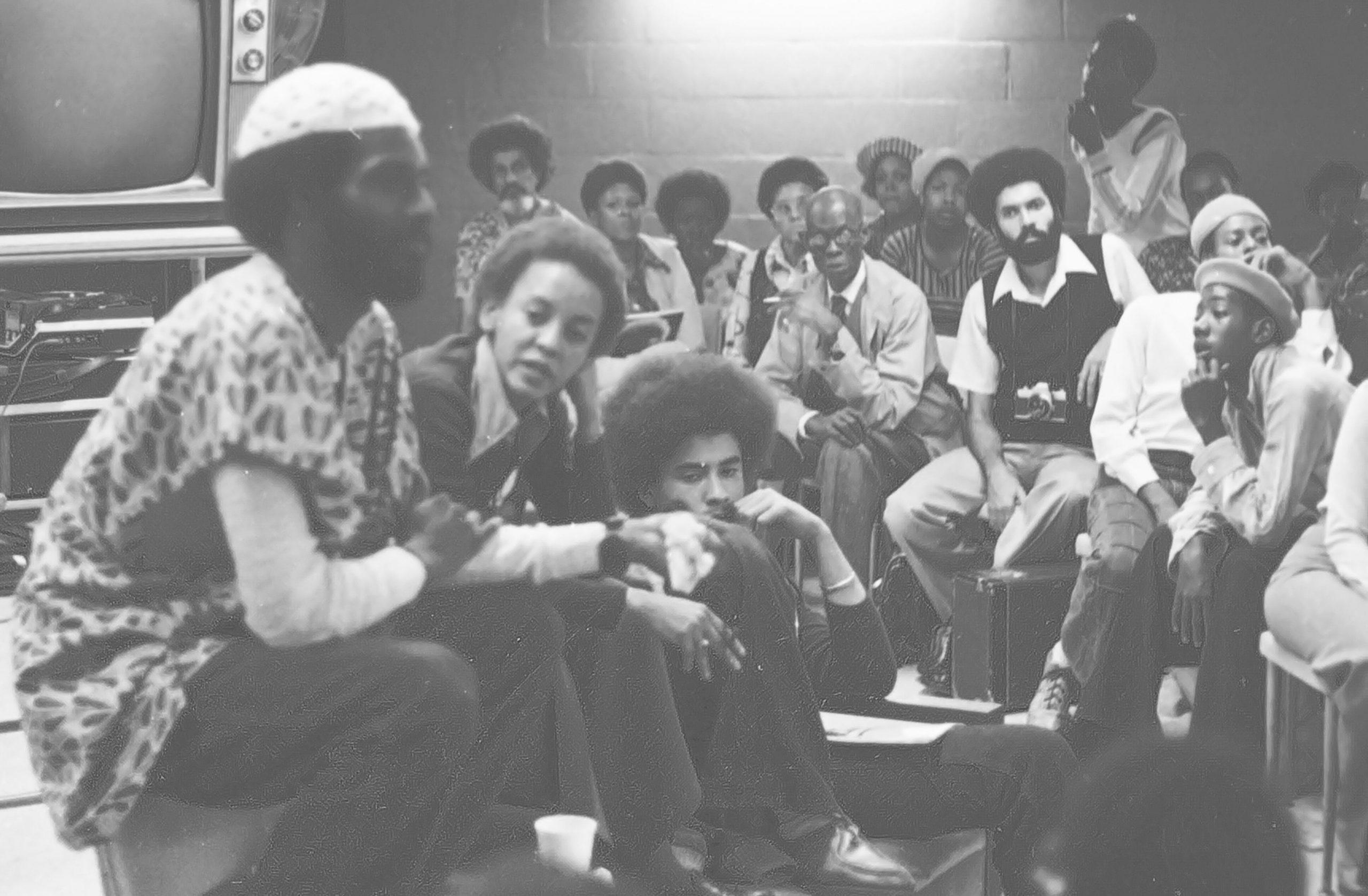 Mwatabu Okantah seated next to Nikki Giovani. Old Ritche Hall, 1975